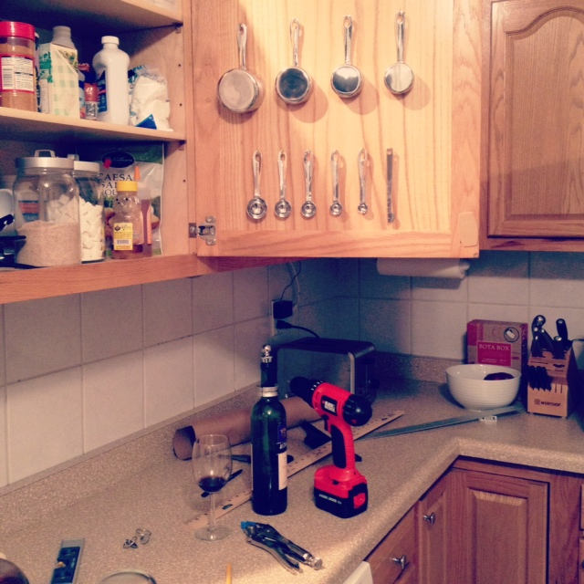 Kitchen cabinet mounted measuring cups and spoons
