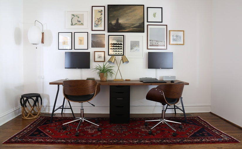 Two person workstation with gallery wall