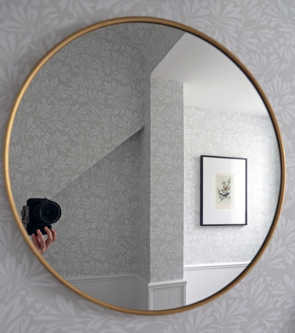 Round Brass Mirror in Bathroom.jpg
