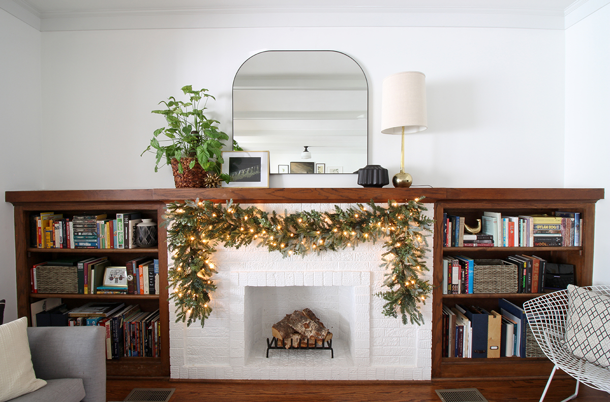 Bungalow Fireplace Mantle with Garland.jpg